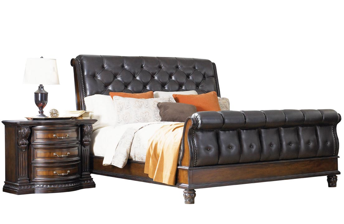 Large leather-looking upholstered black sleigh bed with tufting and wood base
