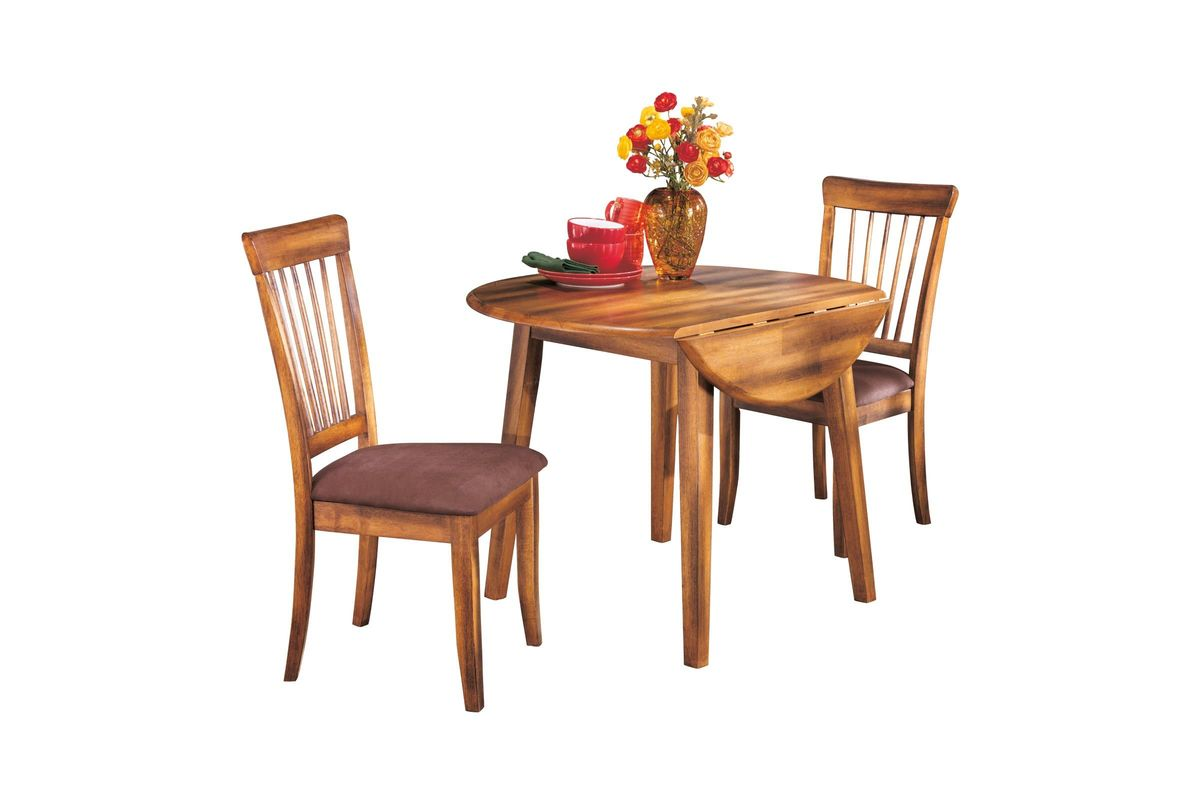 Berringer round dining room drop leaf table by ashley at for White dining room table with leaf