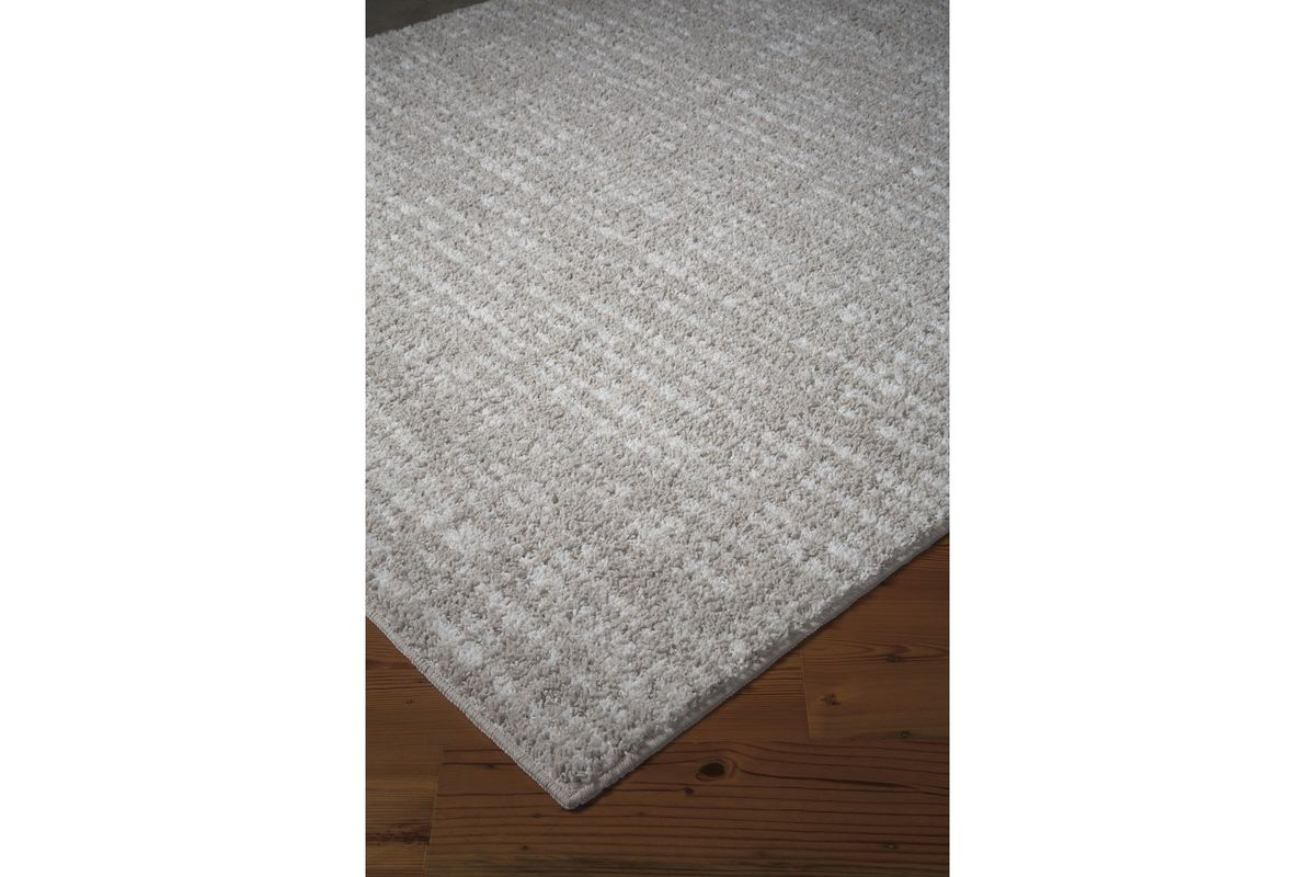 Norris Medium Rug in Taupe by Ashley from Gardner-White Furniture