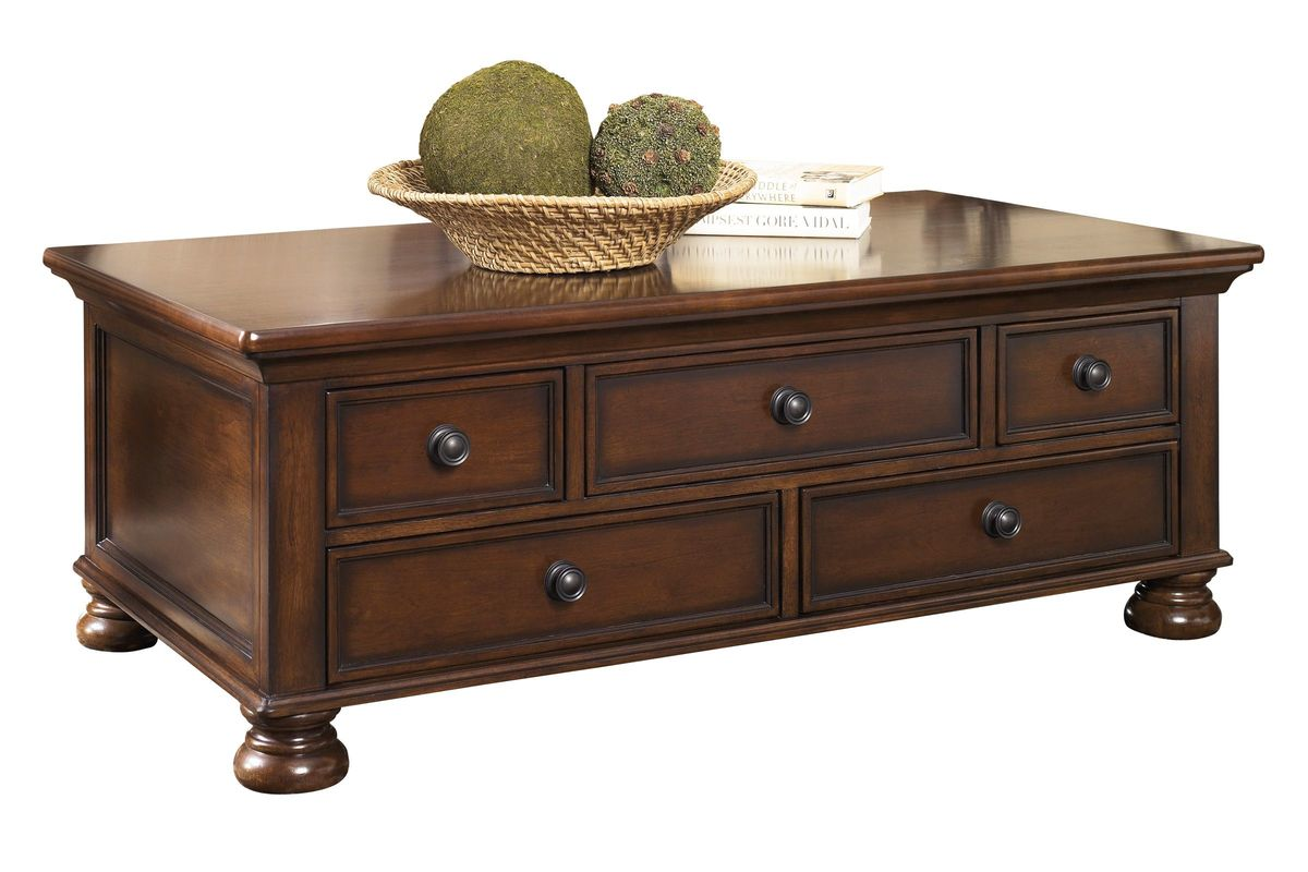 Porter Rectangular Cocktail Table In Rustic Brown By Ashley