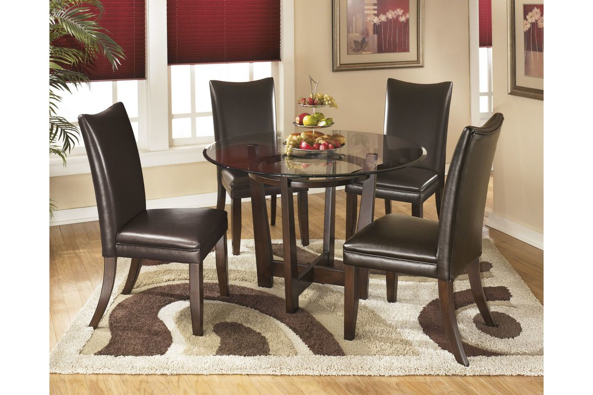 Charrell Round Dining Room Table in Medium Brown by Ashley from Gardner-White Furniture