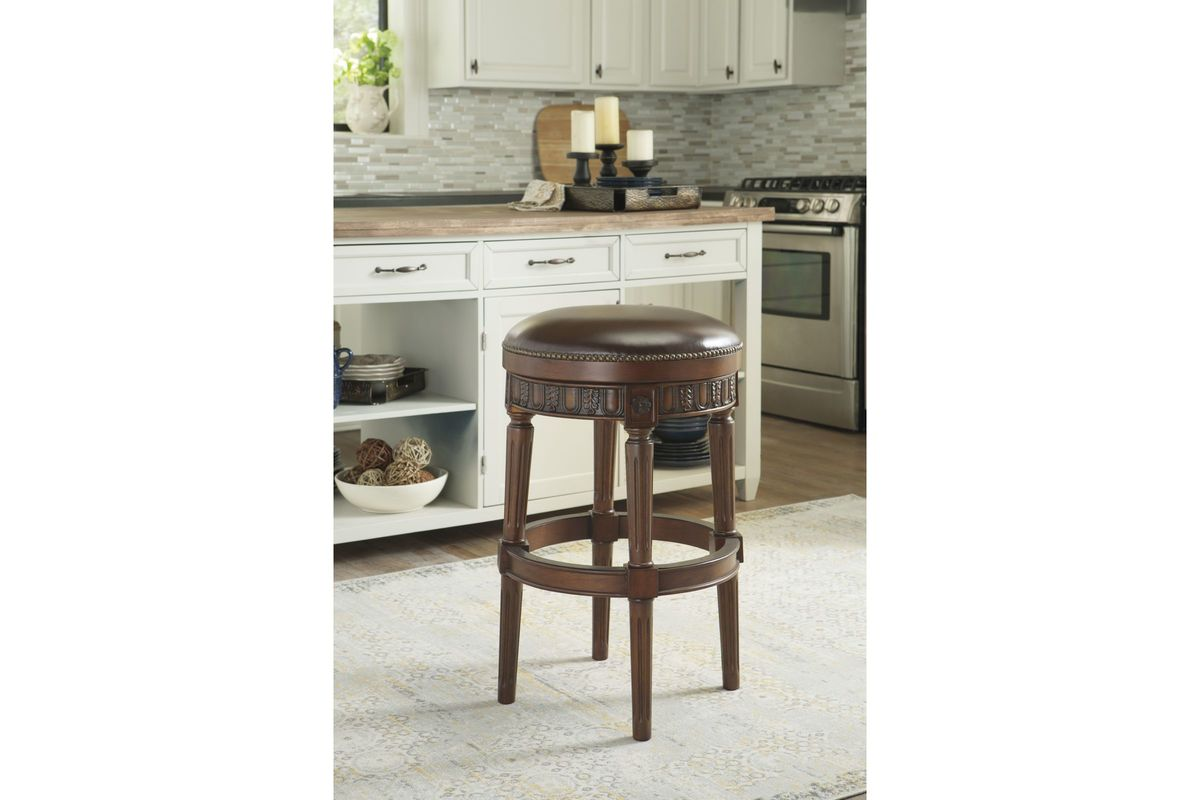 North Shore Tall Uph Swivel Stool In Dark Brown By Ashley