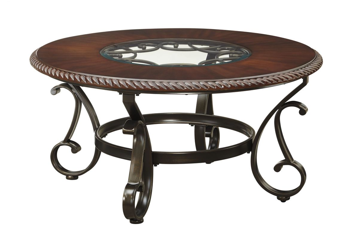 Gambrey round cocktail table in reddish brown by ashley for White and brown coffee table